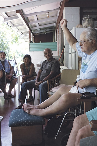 "Photo: Sean LesterImua! At a meeting of Hui O Wa'a Kaulua, Uncle Ed Lindsey proposes the name ""Naleilehua"" for the new double-hulled voyaging canoe that the group has begun constructing. The vessel was named in honor of Ed's father, Ned Naleilehua Lindsey. The name refers to the tallest lehua tree in the forest that shelters and helps nourish the plants that surround it."