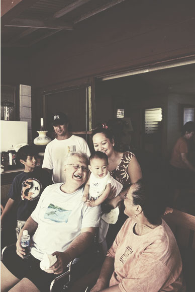 "Photo: Sean LesterCarrying on the legacy. ""This is for my grandchildren, their children and their children's children,"" Ed would frequently say when speaking of the many projects he was involved with. Pictured (left to right) Grandson Ka'elo Lindsey, son Edwin ""Ekolu"" Lindsey III, Ed Lindsey, grandson Keolewa Constantino, daughter Lahela Constantino, sister Roselle Bailey and wife Puanani Lindsey in background."