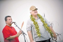 "Kenneth Martinez Burgmaier presents to Uncle Ed Lindsey of Makawao the Malama I Ke Kai kupuna award shaped like an outrigger-canoe paddle at the recent ""More Fish in the Sea: E Ola Ke Kai, E Ola Kakou"" ocean-awareness fair at Maui Community College. Burgmaier, of MauiFest drive-ins and Jazz Alley TV, assisted in coordinating the fair. photo:PAULO MENDES"