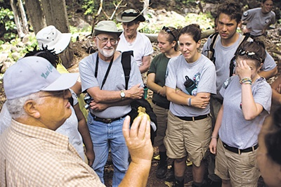 Every Saturday, a crew of volunteers goes to work and learn in Honokowai Valley. Photo: Ray Mangan